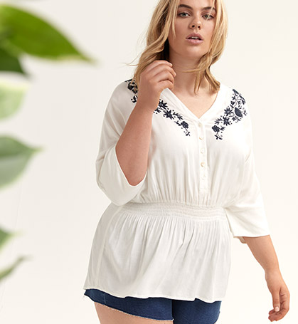 Embroidered blouse with denim shorts