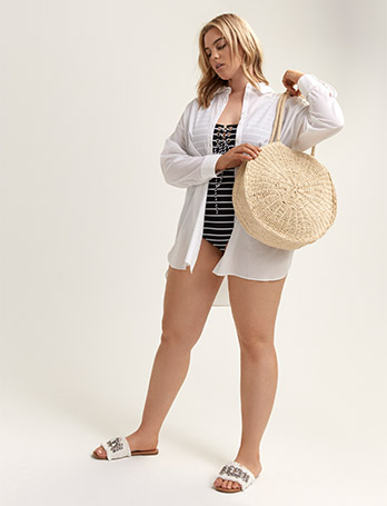 Cover-up shirt with striped one-piece swimsuit and straw bag